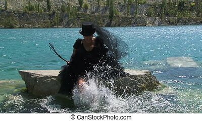 Woman In Black Splashing Water on the Pond - Slow motion...