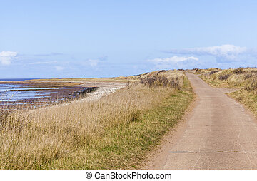 Road over tidal crossing Spurn Point UK - Road over tidal...