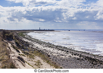 Spurn Point Coastline with LIghthouse - View along Spurn...