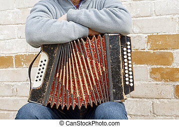 concertina on the mans knee - accordion on the mans knee,...