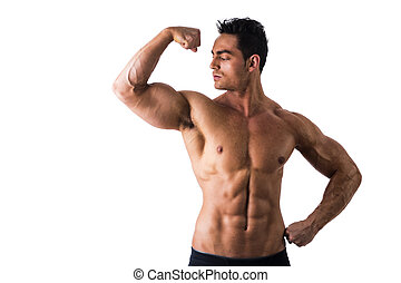 Shirtless Athletic Young Muscle Man Staring at his Biceps -...