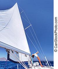 Woman having fun on sailboat