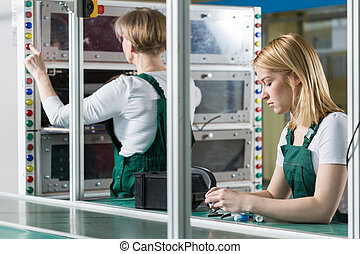Female engineers working in factory - Image of female...