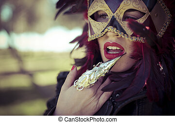 Mystery, beautiful woman with full lips and Venetian mask at...
