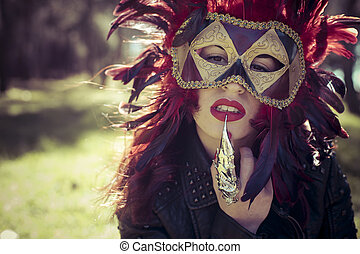 Dramatic, beautiful woman with full lips and Venetian mask...