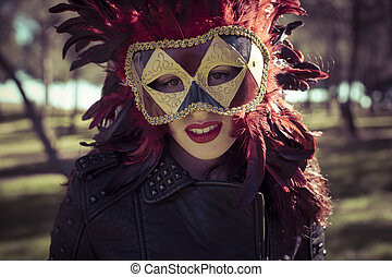 Carnival, beautiful woman with full lips and Venetian mask...