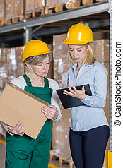 Supervision in manufacturing plant - Vertical view of...