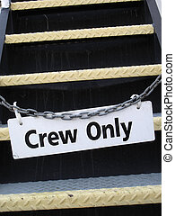 crew only sign on a chain locking stairs