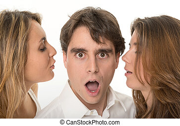 Rumor - Two girls whispering in the ears of a young man with...