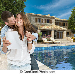 Young couple and dream house - Young couple by a beautiful...