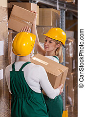 Female storage workers in warehouse
