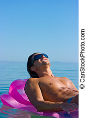 Muscular man - Muscular handsome man in sunglasses relaxing...