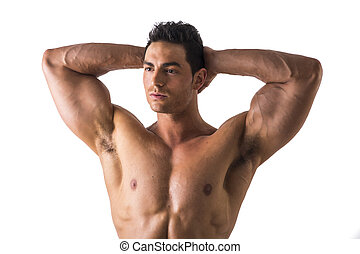 Muscular Man Looking Afar While Holding his Head Showing...