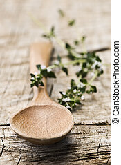 Wooden Spoon - Rustic wooden spoon with fresh herbs on an...