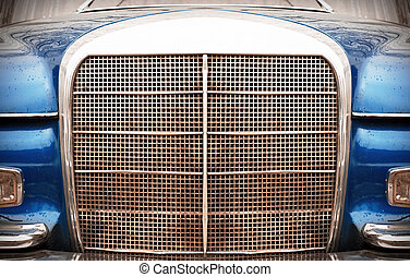 front of the vintage car, headlights, grill and bumper