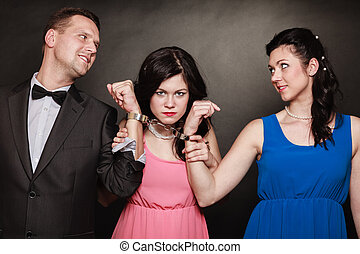 Marital infidelity concept. Love triangle two women one man...
