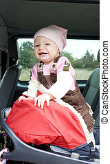 little girl standing in car seat