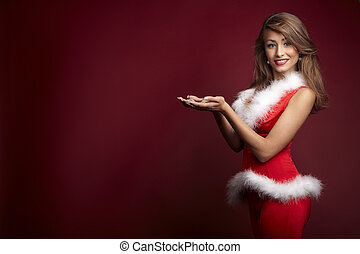 Sexy santa helper on red background