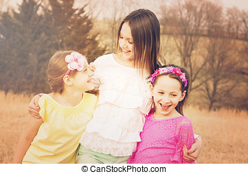Three sisters arms around each othe - Three girl siblings...