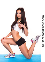 Beautiful young woman exercising in a fitness center -...