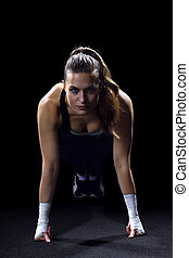 Push Ups - woman working out doing push ups