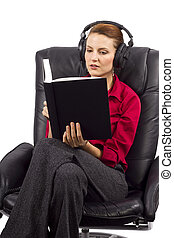 Learning a Language - woman learning with audio books