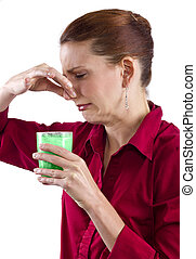 Grossed Out - woman grossed out by green vegetable juice