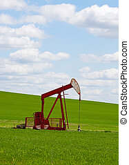 Prairie Pump Jack - An oil well with the pump jack in...