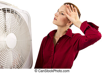 Heatwave - Businesswoman cooling off with a fan