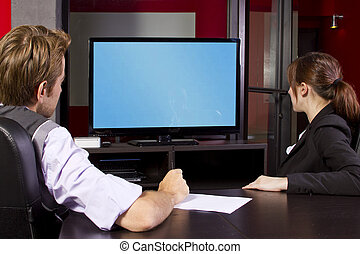 Corporate Video Presentation - Business team watching a...