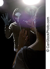 Alien Abduction - Gray alien with lights behind abducting a...