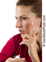 Anti Aging Cream - woman applying anti aging cream ointments