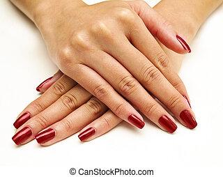 Nail Spa  - close up of nails with red nail polish