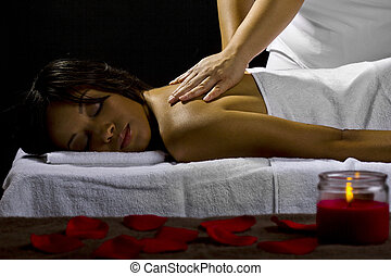 Massage in Dark Room - young female getting a massage in a...