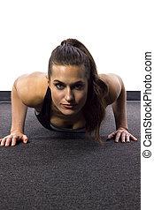 Push Ups - young Caucasian woman doing push ups