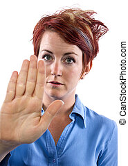 Stopping Gesture - young redhead woman holding out her palm