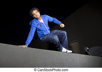 Parkour at Night - free runner doing parkour at night on a...