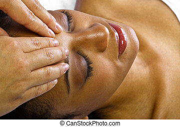 Head Massage - young black female getting a head massage /...