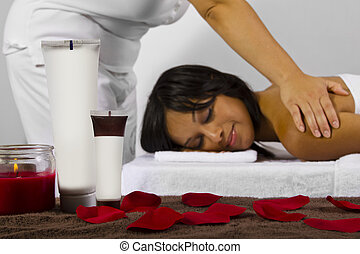 Spa Products - spa products on foreground, masseuse and...