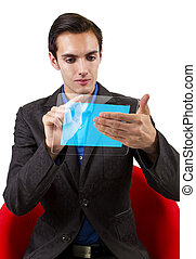 See Through Tablet - young male browsing on a hi-tech tablet