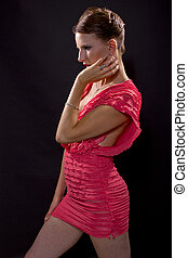 Seductress in a Pink Dress - young caucasian woman with a...