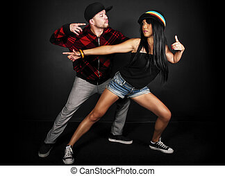 Hip Hop Duo male and female - hip hop dance crew on a black...
