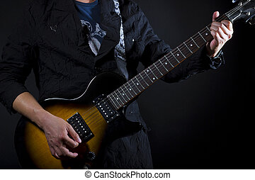Guitar Lessons - close up of guitar lessons (showing chords)