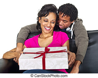 Surprise Gift - man giving his girlfriend a surprise gift
