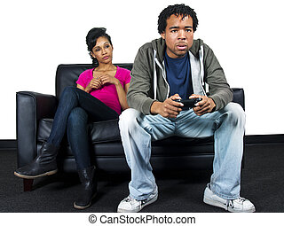 Video Games - man playing video games with bored girlfriend