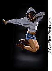 Latina Dancer Jumping - latina dancer wearing a hoodie...