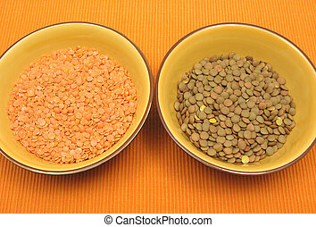 Two bowls of ceramic with lentils and red lentils