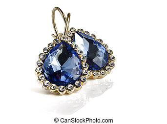 Earrings on a white background with reflection.