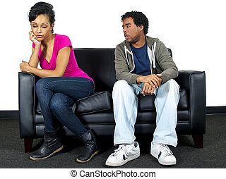 relationship problems - man and woman fighting on the couch