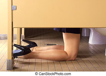 Woman Throwing Up - woman in a bathroom stall throwing up in...